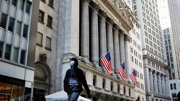 A man wears a mask as he walks near the New York Stock Exchange (NYSE) in the financial district in New York City, U.S., March 2, 2020. - Sputnik International