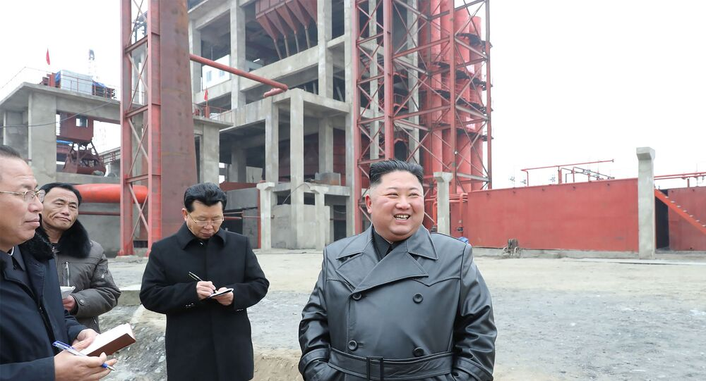 North Korean leader Kim Jong Un (R) visiting the construction site of the Sunchon phosphatic fertiliser factory in South Pyongan province