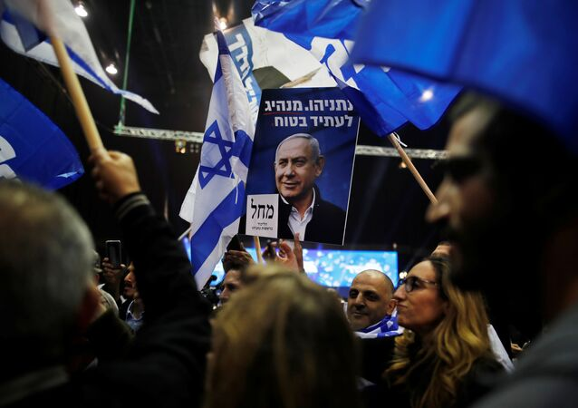Supporters react as results of the exit polls in Israel's elections are announced at Israeli Prime Minister Benjamin Netanyahu's Likud party headquarters in Tel Aviv, Israel March 2, 2020