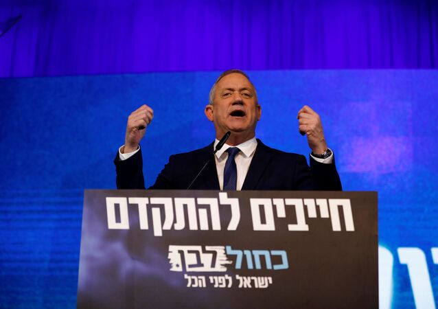 Blue and White party leader Benny Gantz gestures as he speaks to supporters following the announcement of exit polls in Israel's election at the party's headquarters in Tel Aviv, Israel March 3, 2020
