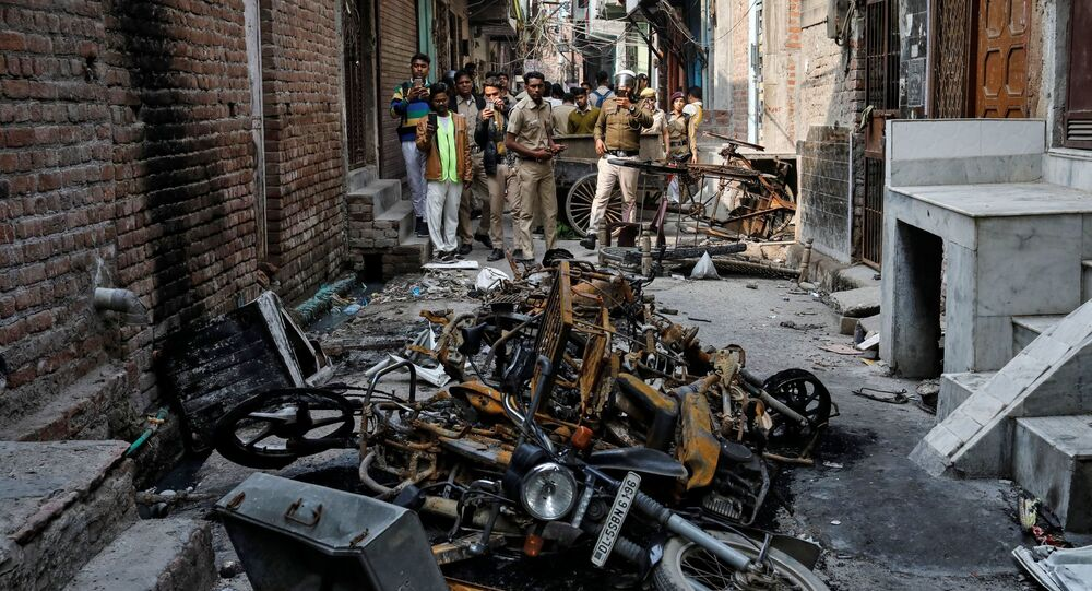Police photograph burnt out properties owned by Muslims in a riot affected area following clashes between people demonstrating for and against a new citizenship law in New Delhi, India, March 2, 2020