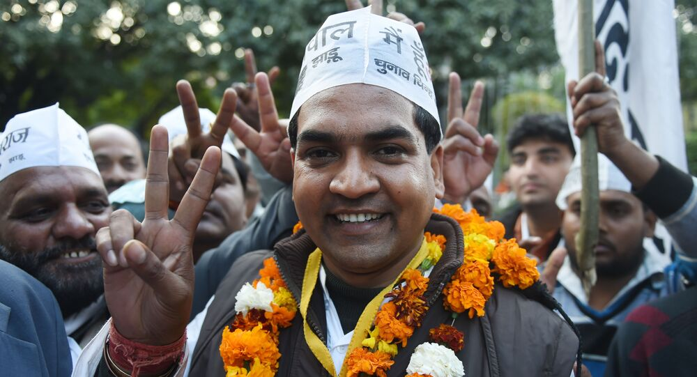Senior Leader of India's Aam Aadmi Party (AAP) Kapil Mishra gestures as he arrives for a meeting in New Delhi on February 10, 2015