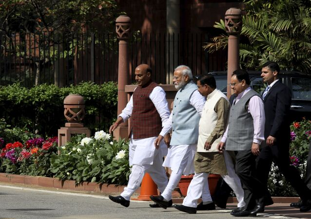 Indian Prime Minister Narendra Modi, second left, accompanied by other leaders leaves after Bharatiya Janata Party (BJP) parliamentary party meeting in New Delhi, India, Tuesday, March 3, 2020