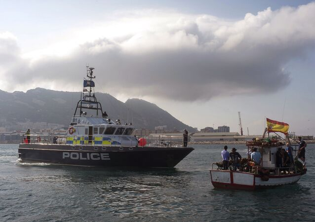 A British patrol boat, left, blocks access as fishermen, right, protest near to La Linea de la Concepcion in front of Gibraltar, Spain, Sunday, Aug. 18, 2013