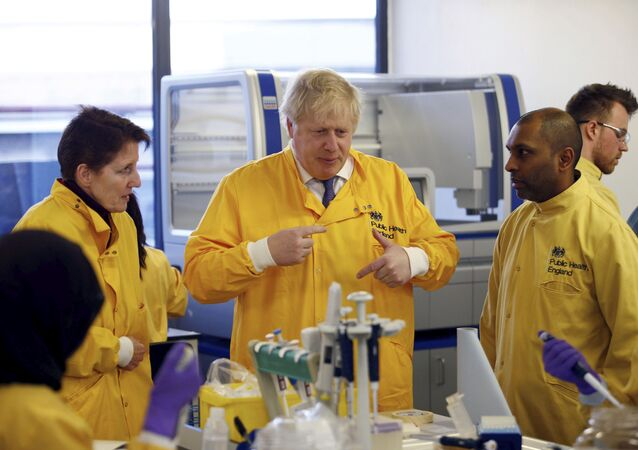 Britain's Prime Minister Boris Johnson visits a laboratory at the Public Health England National Infection Service on 1 March 2020