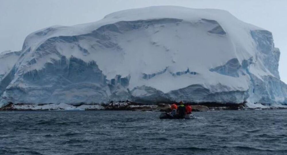 Researchers from the R/V Nathaniel B. Palmer icebreaker approach the newly-discovered Sif Island to collect rock samples