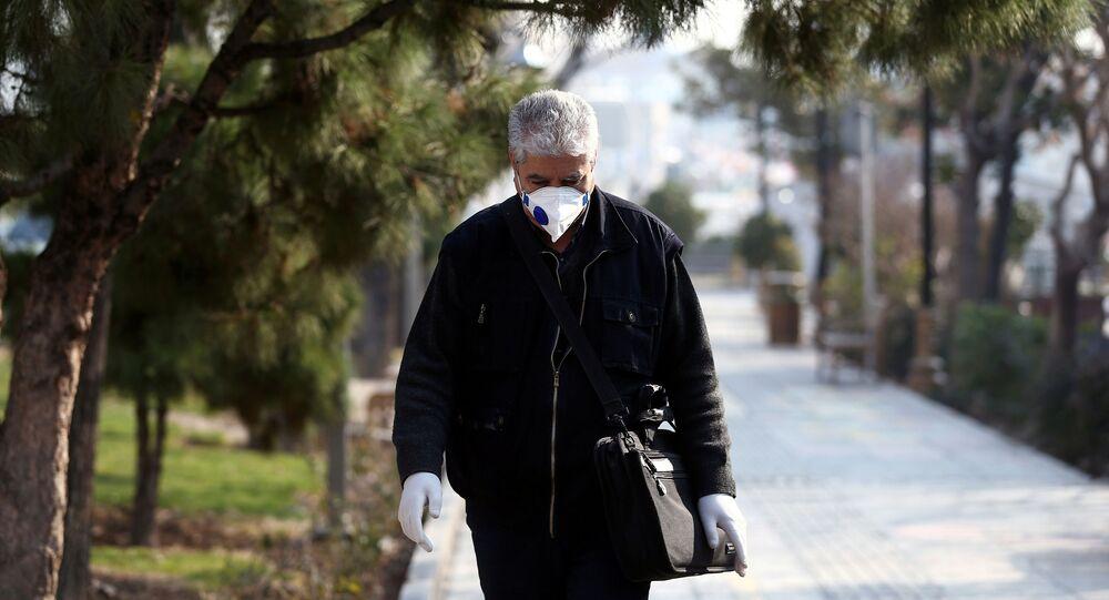 An Iranian man wears a protective mask against the coronavirus as he walks on a street in Tehran, Iran February 29, 2020