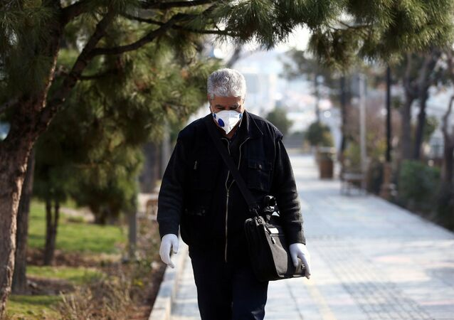 An Iranian man wears a protective mask against the coronavirus as he walks on a street in Tehran, Iran February 29, 2020