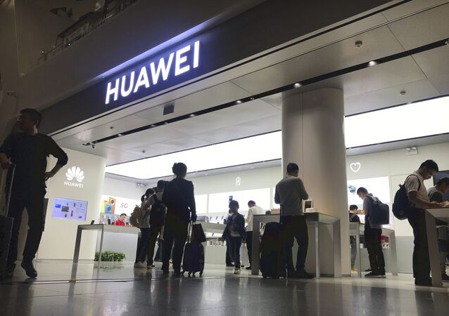 People look at a Huawei store in Shenzhen Bao'an International Airport in Shenzhen in southern China's Guangdong Province, Friday, Nov. 15, 2019