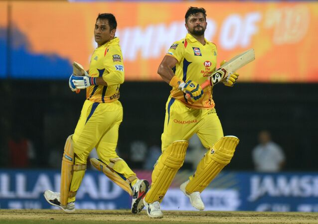Chennai Super Kings cricketer captain Mahendra Singh Dhoni (L) and Suresh Raina (R) run between the wickets during the 2019 Indian Premier League (IPL) Twenty20 cricket match between Chennai Super Kings and Rajasthan Royals at the M.A. Chidambaram Stadium in Chennai on March 31, 2019