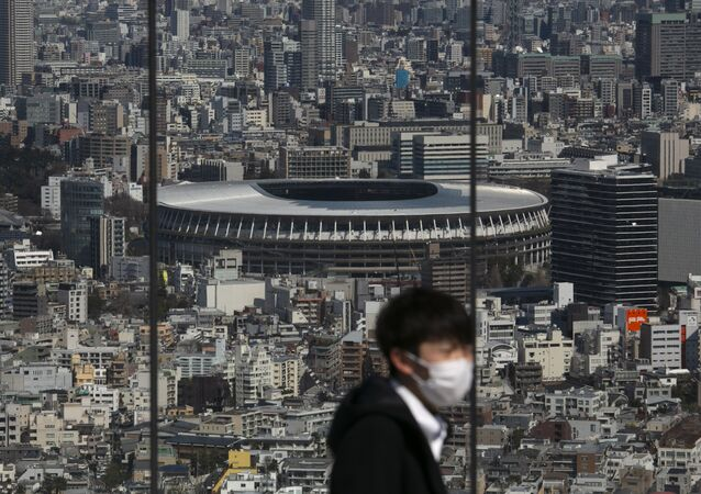 The New National Stadium, a venue for the opening and closing ceremonies at the Tokyo 2020 Olympics, is seen from Shibuya Sky observation deck in Tokyo, Tuesday, March 3, 2020.