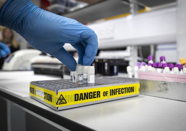 Clinical support technician Douglas Condie extracts viruses samples as analytic work continues to examine the genetic structure of a virus in the coronavirus testing laboratory at Glasgow Royal Infirmary, Glasgow, Scotland, Wednesday Feb. 19, 2020