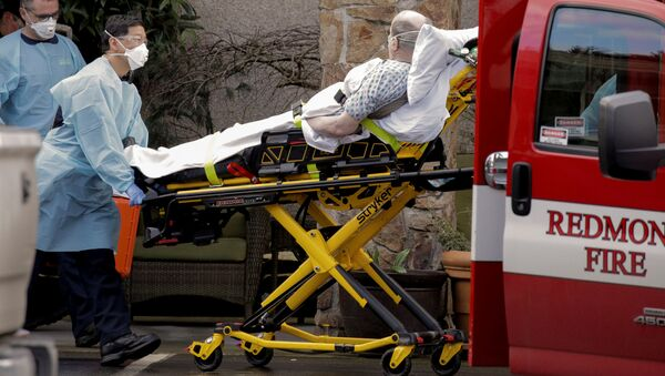 Medics transport a man on a stretcher into an ambulance at the Life Care Center, a long-term care facility linked to several confirmed coronavirus cases, in Kirkland, Washington, U.S. March 3, 2020 - Sputnik International