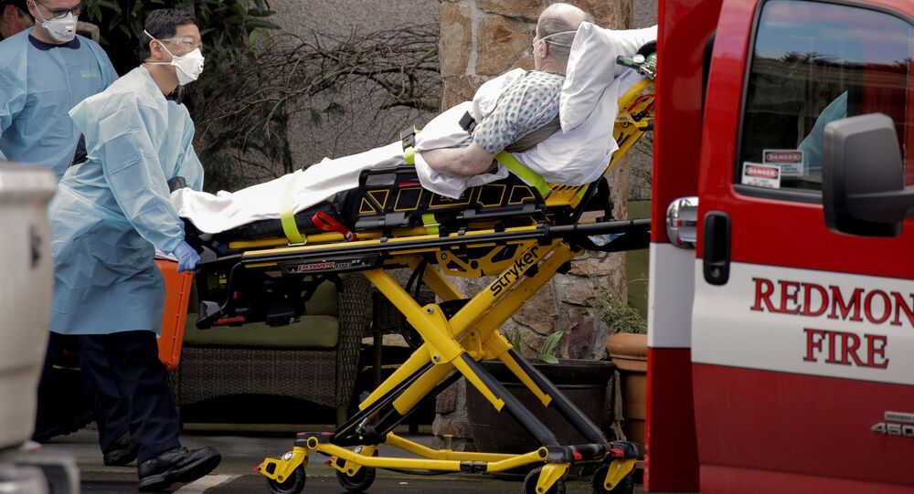 Medics transport a man on a stretcher into an ambulance at the Life Care Center, a long-term care facility linked to several confirmed coronavirus cases, in Kirkland, Washington, U.S. March 3, 2020