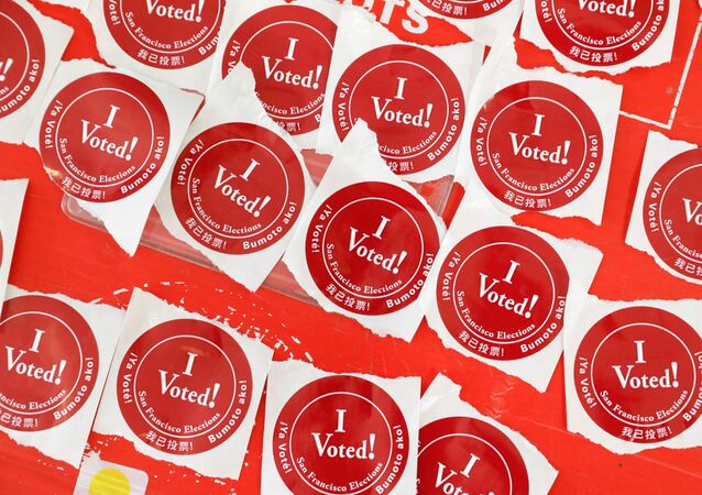 "A table of ""I voted!"" stickers are seen at a polling station as voters cast their ballots for the presidential primary election on Super Tuesday in San Francisco, California, U.S. March 3, 2020"