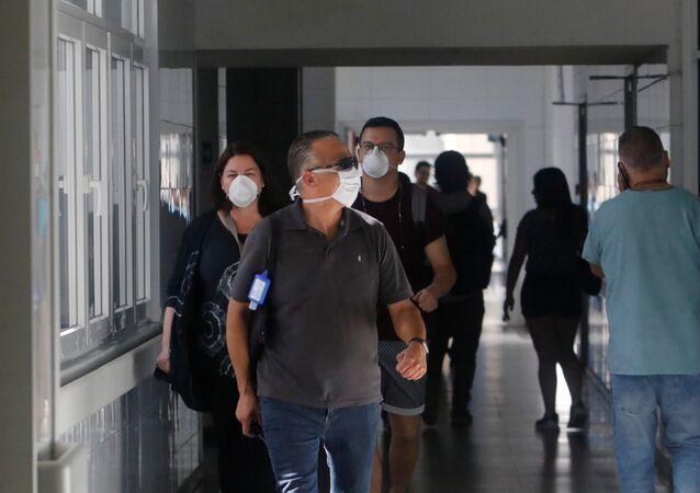 Locals wear masks inside Talca regional hospital in Talca, Chile