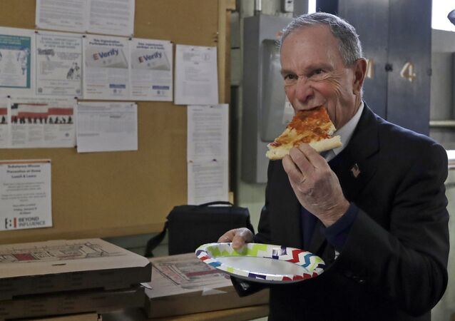 Potential Democratic presidential candidate Michael Bloomberg eats a slice of pizza after a tour of the WH Bagshaw Company, a pin and precision component manufacturer, Tuesday Jan. 29, 2019, in Nashua, N.H.