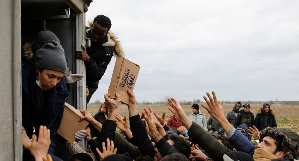 Members of United Nations High Commissioner for Refugees deliver food to migrants at Turkey's Pazarkule border crossing with Greece's Kastanies, in Edirne, Turkey, February 29, 2020.