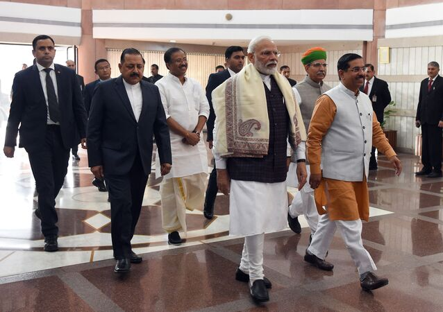 Indian Prime Minister Narendra Modi (C) arrives to attend a BJP Parliamentary committee meeting at Parliament in New Delhi on February 4, 2020.