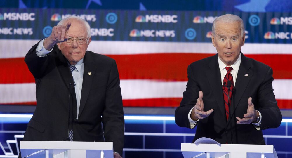 Democratic presidential candidates, Sen. Bernie Sanders, I-Vt., left, and former Vice President Joe Biden gesture during a Democratic presidential primary debate Wednesday, Feb. 19, 2020, in Las Vegas, hosted by NBC News and MSNBC. (AP Photo/John Locher)
