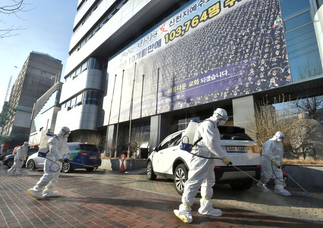 Workers from a disinfection service company sanitize a street in front of a branch of the Shincheonji Church of Jesus the Temple of the Tabernacle of the Testimony where a woman known as Patient 31 attended a service in Daegu, South Korea, February 19, 2020