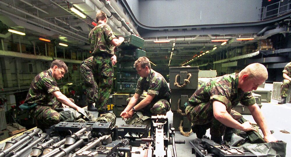 British Royal Marines from the 42nd Commando unit  check their equipment on the British Royal Navy helicopter carrier HMS Ocean in Marseille Sunday May 7, 2000