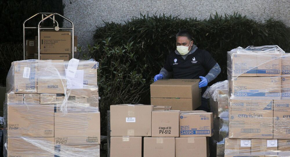 A worker organizes a delivery at the Life Care Center of Kirkland, the long-term care facility linked to several confirmed coronavirus cases in the state, in Kirkland, Washington, U.S. March 4, 2020