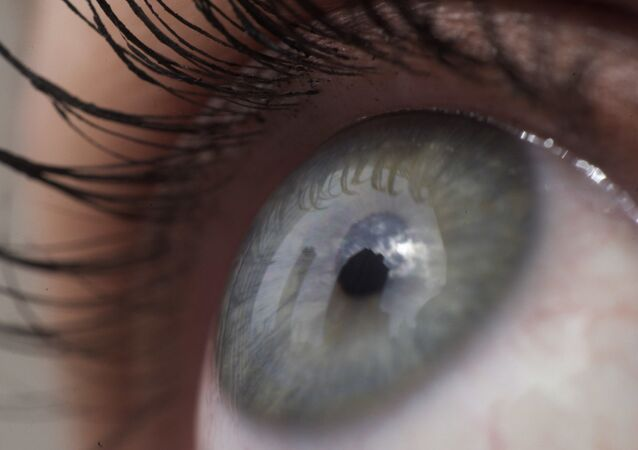 This April 12, 2018 file photo shows the eye of a woman in New York.   Patients are about to be enrolled in the first study to test gene editing inside the body to try to cure an inherited form of blindness. People with the disease have healthy eyes but lack a gene that converts light into signals to the brain that enable sight