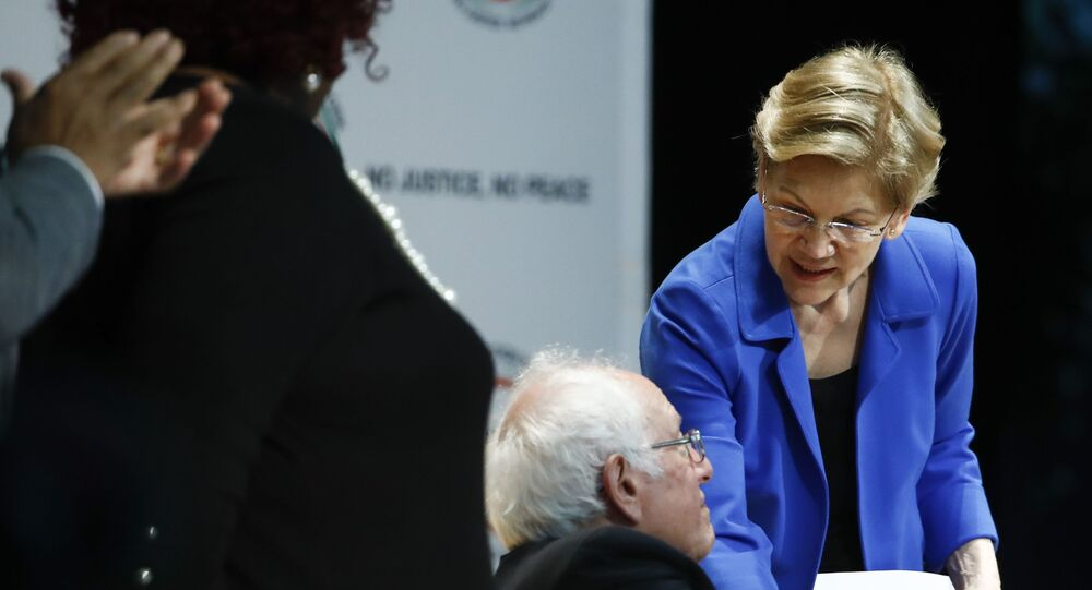 Democratic presidential candidate Sen. Elizabeth Warren, D-Mass., shakes hands with Democratic presidential candidate Sen. Bernie Sanders, I-Vt., after speaking at the National Action Network South Carolina Ministers' Breakfast, Wednesday, Feb. 26, 2020, in North Charleston, S.C. (AP Photo/Matt Rourke)