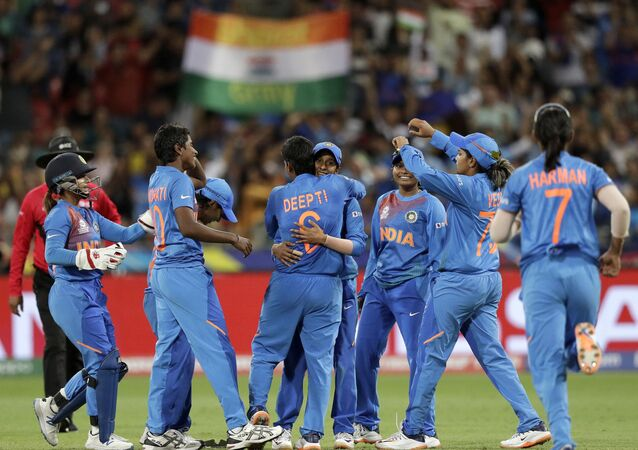 The Indian team celebrate the wicket of Australia's Ashleigh Gardner in the first game of the Women's T20 Cricket World Cup in Sydney, Friday, Feb. 21, 2020