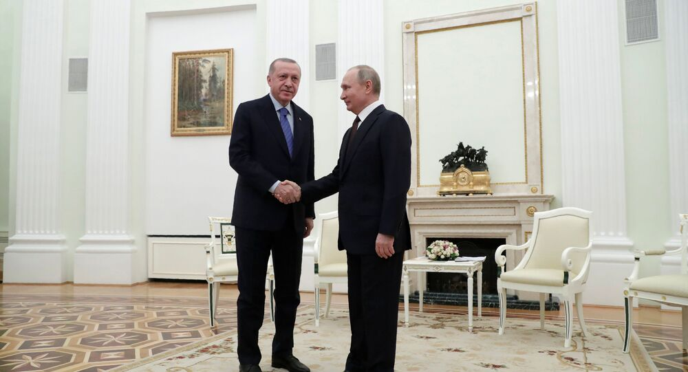 Russian President Vladimir Putin shakes hands with Turkish President Tayyip Erdogan during a meeting in Moscow, Russia March 5, 2020