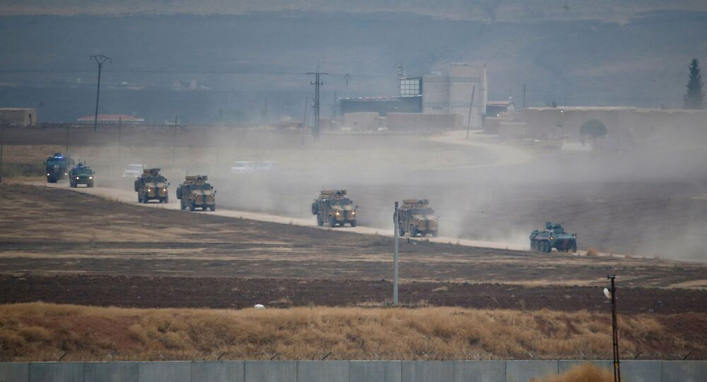 Turkish and Russian military vehicles return following a joint patrol in northeast Syria, as they are pictured from near the Turkish border town of Kiziltepe in Mardin province, Turkey, November 1, 2019