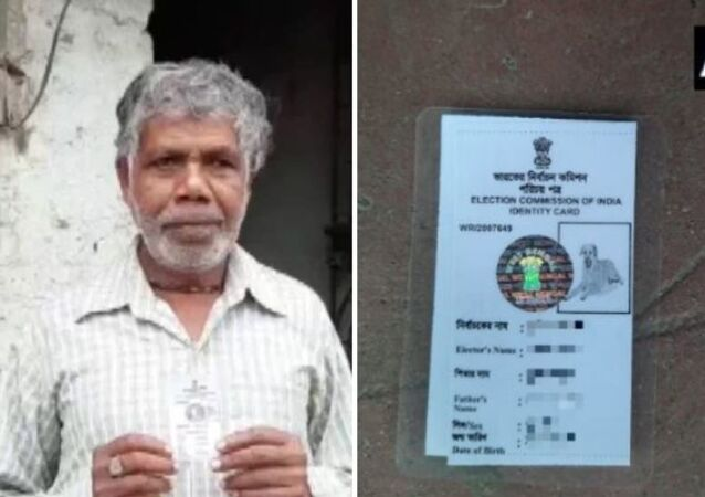 North Bengal resident Sunil Karmakar with his voter ID card that carries a dog's