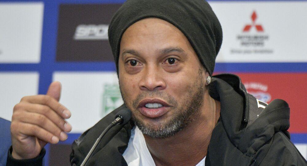 Brazilian former footballer Ronaldinho Gaucho gestures during a press conference in Bogota on October 16, 2019