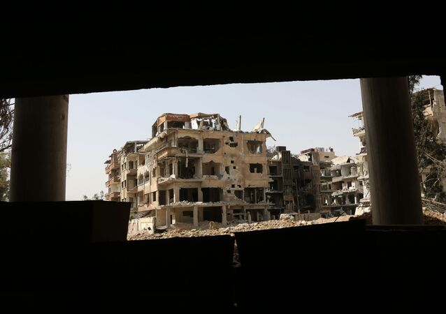 A general view shows destroyed buildings in the former rebel-held Syrian town of Douma on the outskirts of Damascus on April 19, 2018