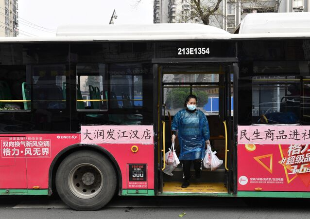 A worker unloads bags of groceries purchased by residents through group orders from a bus in Wuhan, the epicentre of the novel coronavirus outbreak, Hubei province, China March 5, 2020