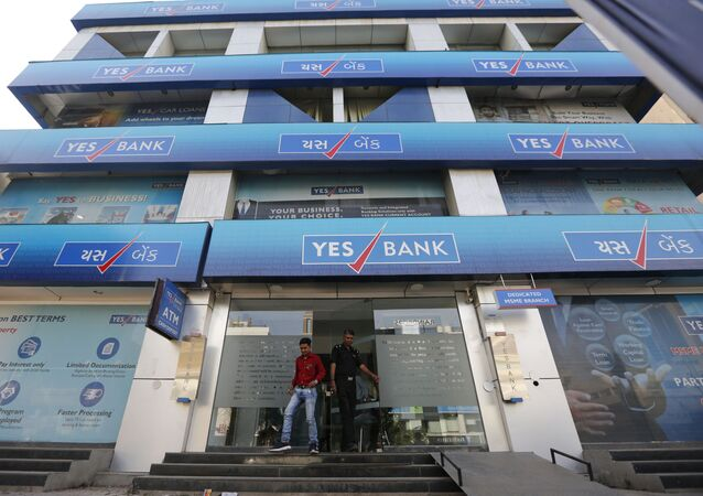 An Indian man walks out of a Yes Bank building in Ahmadabad, India