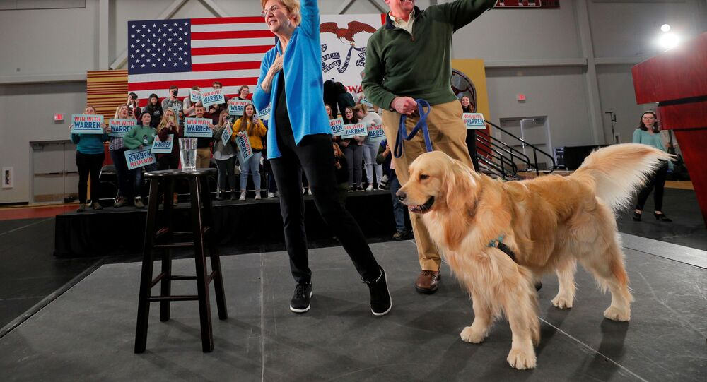 Democratic 2020 U.S. presidential candidate and U.S. Senator Elizabeth Warren (D-MA) is joined onstage by her husband Bruce and their dog Bailey at a Get Out the Caucus Rally in Cedar Rapids, Iowa, U.S., 1 February 2020.