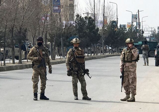 Afghan security forces keep watch near the site of an attack in Kabul, Afghanistan 6 March 2020.