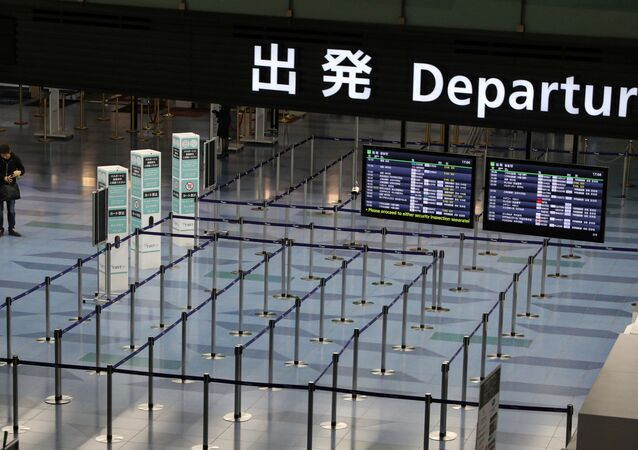 An empty departures gate is pictured at Haneda Airport in Tokyo, Japan, 4 March 2020.