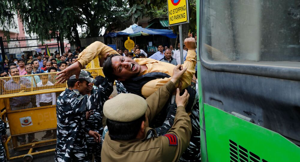 Police detains an activist of the youth wing of India's main opposition Congress party during a protest demanding the resignation of Home Minister Amit Shah following last week's clashes between people demonstrating for and against a new citizenship law in New Delhi, India March 2, 2020