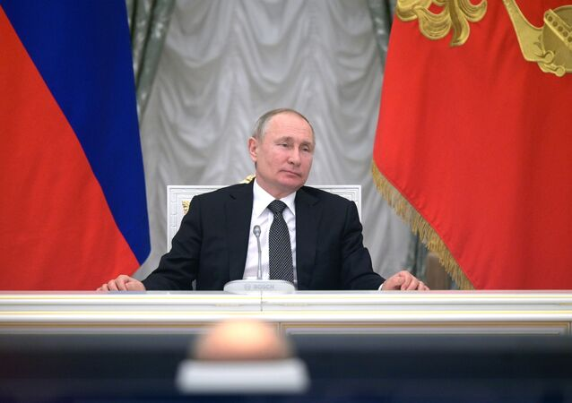 Russian President Vladimir Putin attends a meeting with members of a working group created to discuss constitutional amendments in the Kremlin in Moscow, Russia, Wednesday, Feb. 26, 2020