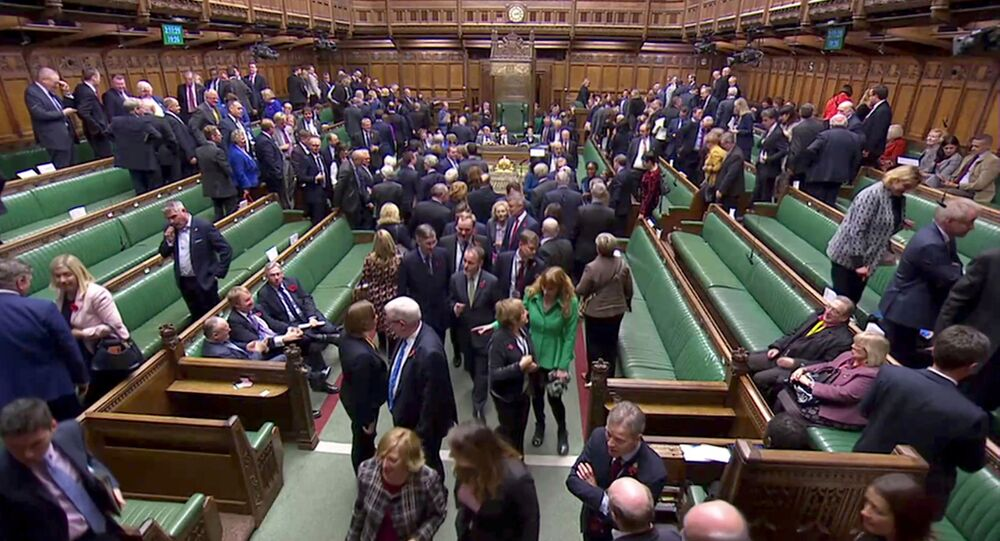 FILE PHOTO: MPs leave the House of Commons to vote in the election of the new Speaker of the House, in London, Britain November 4, 2019, in this screen grab taken from video. Parliament TV via REUTERS./File Photo