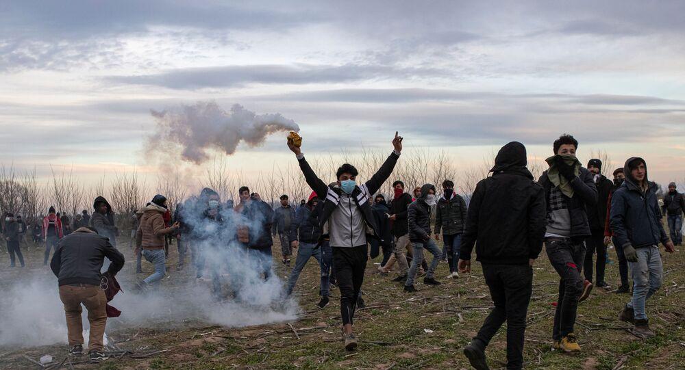 Migrants at Turkey's Pazarkule border crossing with Greece's Kastanies, near Edirne, Turkey