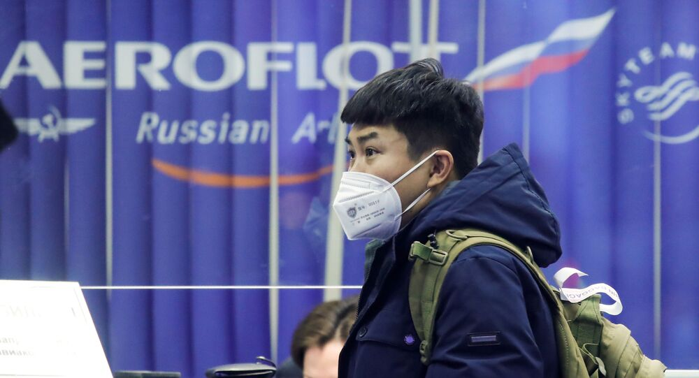 A passenger near the booking office of Russia's flagship airline Aeroflot at Sheremetyevo International Airport, Moscow