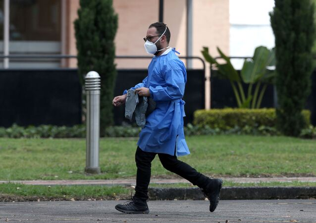 A man wearing face mask walks outside a sports centre in Bogota, Colombia February 28, 2020