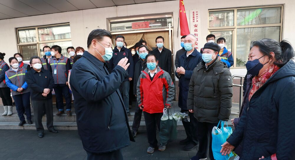 Chinese President Xi Jinping inspects the novel coronavirus prevention and control work at Anhuali Community in Beijing, China, February 10, 2020. Xinhua via REUTERS
