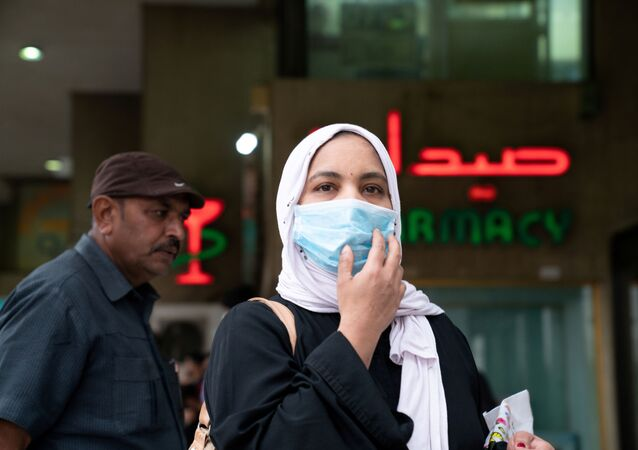 A woman wears a protective face mask, following the outbreak of the new coronavirus, in Kuwait, February 25, 2020