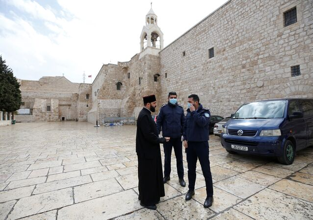 Palestinian police officers stand guard outside the Church of the Nativity that was closed as a preventive measure against the coronavirus, in Bethlehem in theWest Bank March 6, 2020