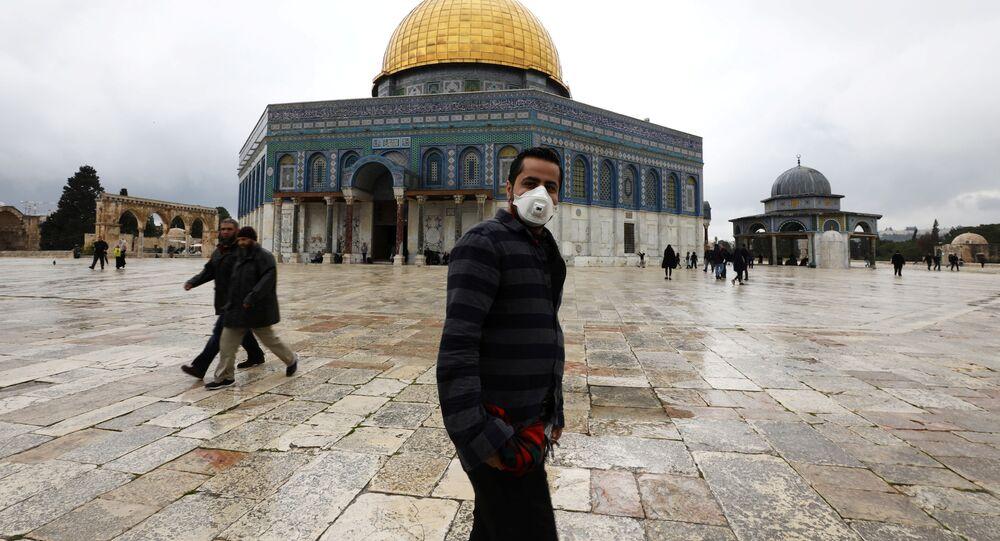 A man wears a face mask in Jerusalem's Old City